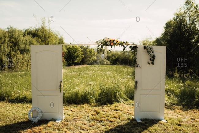 Doors with flower arrangement as wedding d_cor