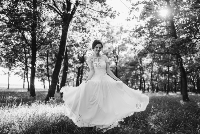Bride spinning in her wedding gown