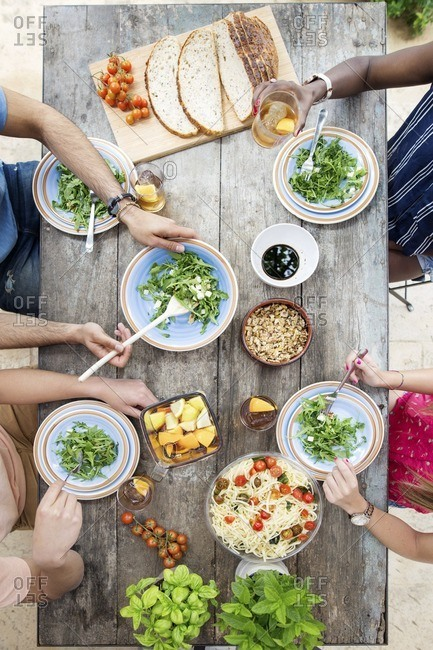 Overhead view of friends having lunch at outdoor table