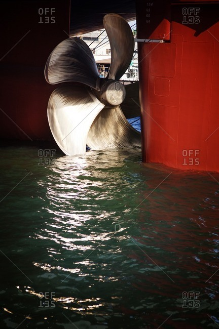Close-up of propeller on container ship in water