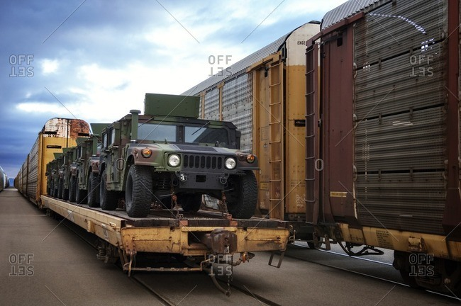 Military vehicles loaded on train