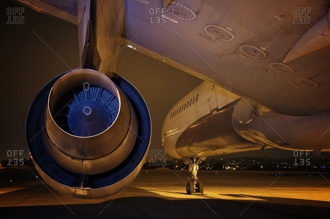 Close-up of jet engine at airport during night