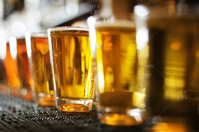 Row of beer glasses on table