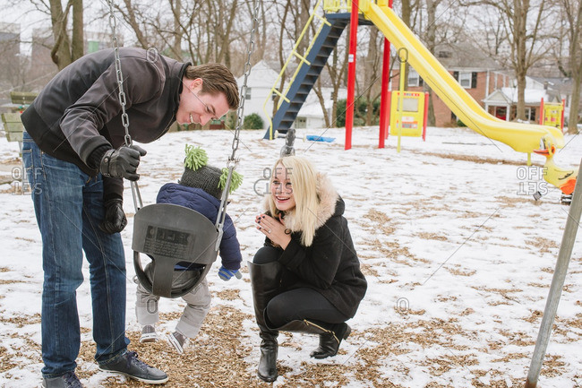 Parents with toddler in swing