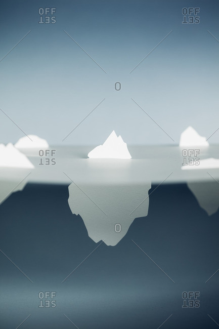 Tips of paper icebergs above the surface of the water