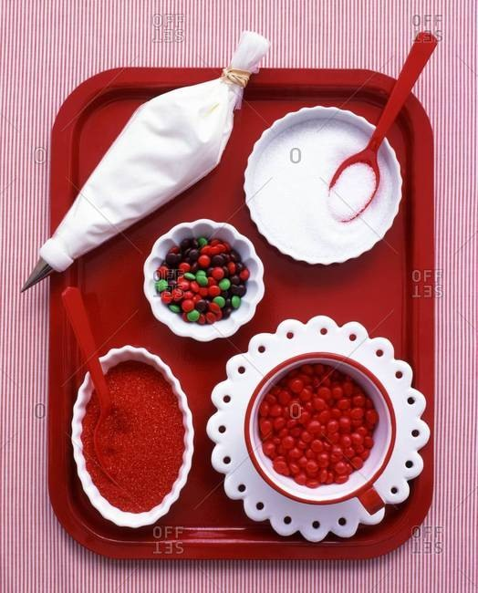 Assorted sweets on a red tray