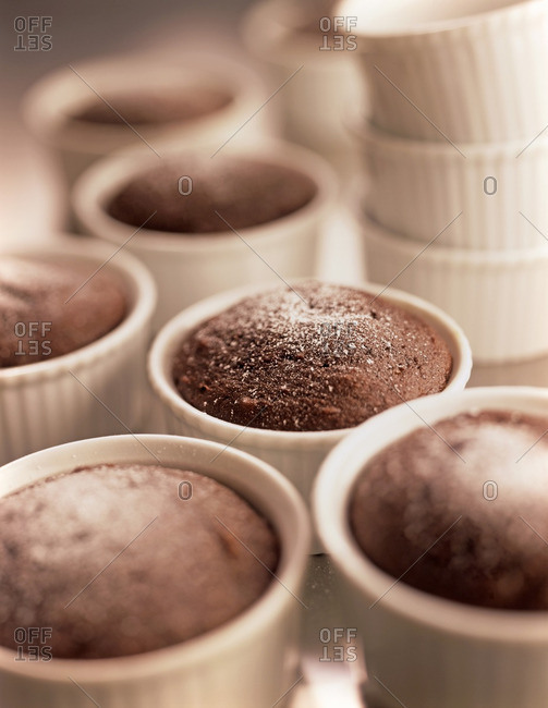 Close-up of Chocolate Cakes and Ramekins on Kitchen Counter, Studio Shot