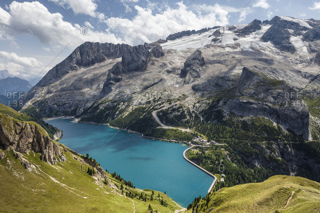 Lake Fedaia, at the foot of Marmolada, Queen of Dolomites, on the border between Trentino Alto Adige and Veneto, Italy