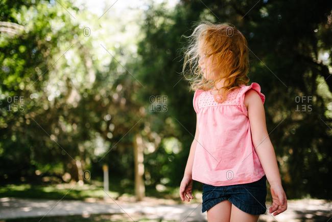 Girl with windblown hair looking away