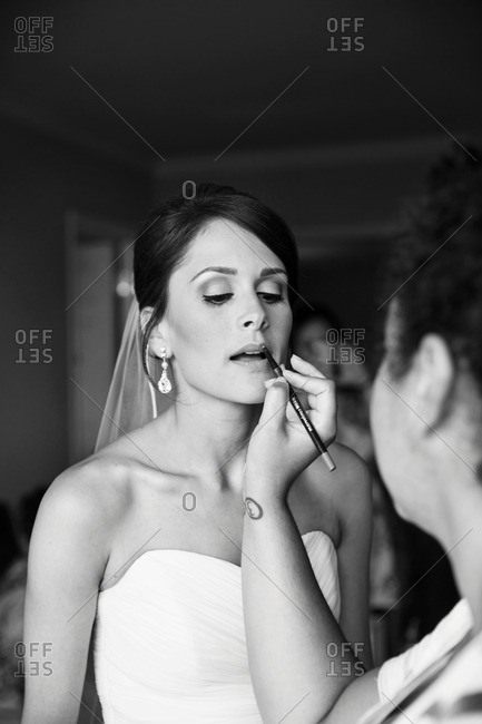 Woman doing bride's lipstick