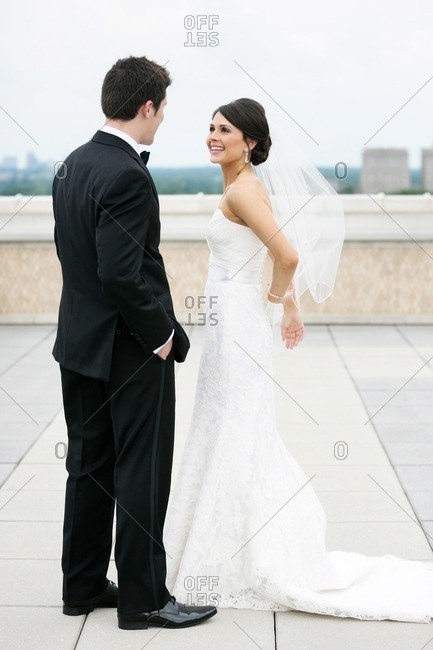 Bride and groom standing together on a rooftop