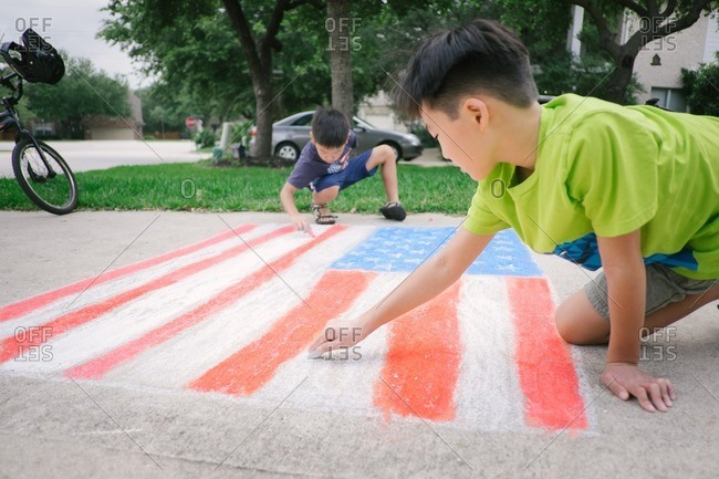 Boys drawing American flag