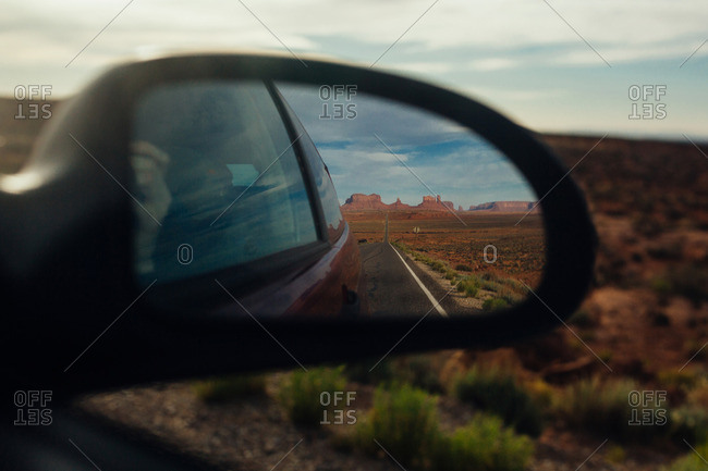 Monument Valley reflected in a car's side mirror