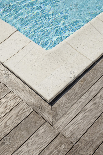 Wooden deck beside a pool
