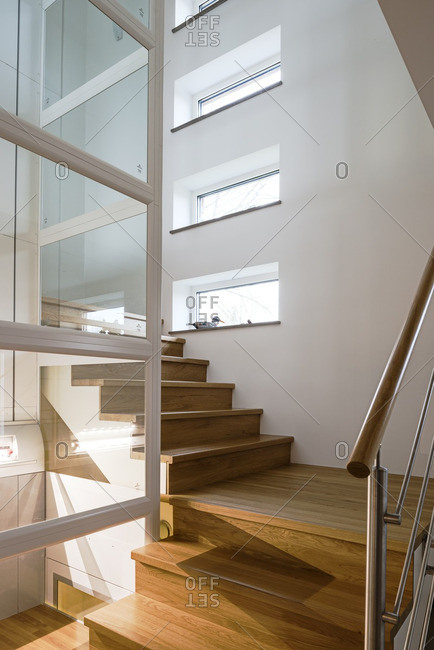 Staircase next to a glass elevator