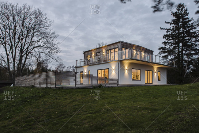 11/9/14: Contemporary house with wooden fence at dusk