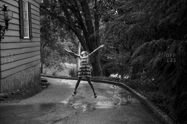 Girl dancing and playing in the rain