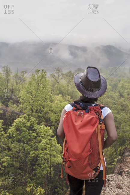 Female Asian hiker looking at view in Pai Canyon, Thailand