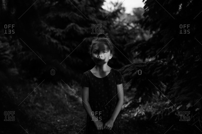black and white of girl in tree lines
