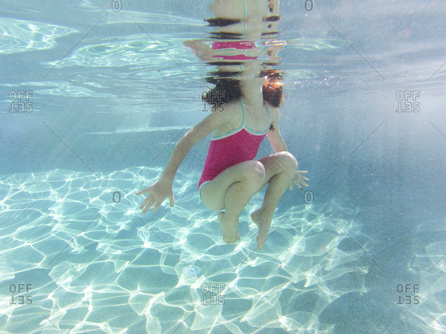 Young girl underwater in a swimming pool