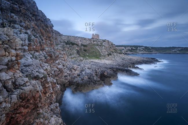 Rocky coastline at dusk - Offset