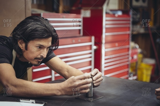 Man working on a part in a metal shop