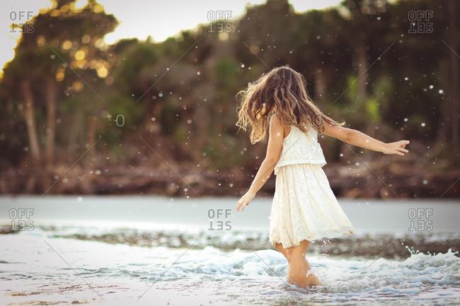 Girl in dress in sea splash