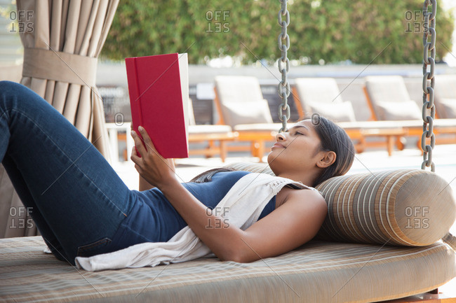Indian woman reading book at home