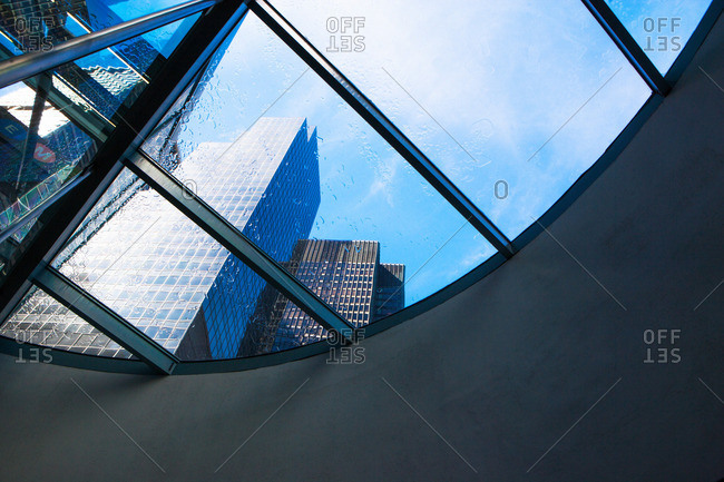 Skyscrapers  from curved window in financial district, Manhattan, New York, USA