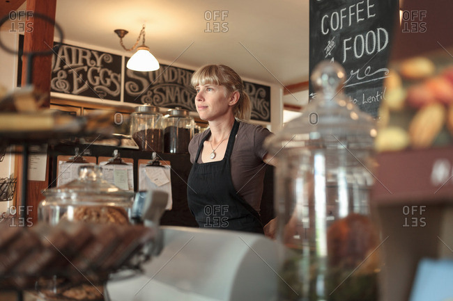 Female shop assistant in country store cafe