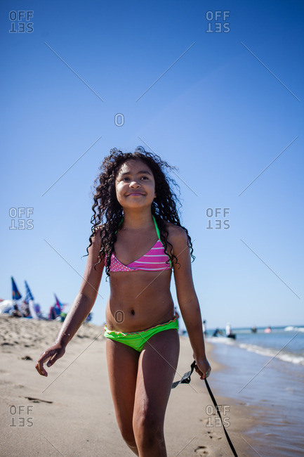 Girl strolling on beach with seaweed, Truro, Massachusetts, Cape Cod, USA