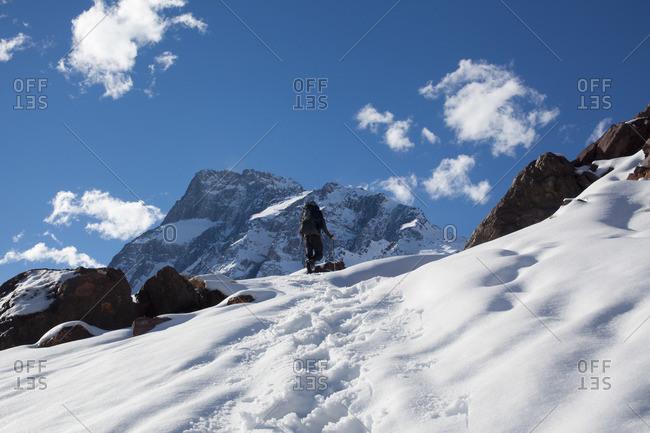 Mountain climber climbing mountain, Santiago, Chile