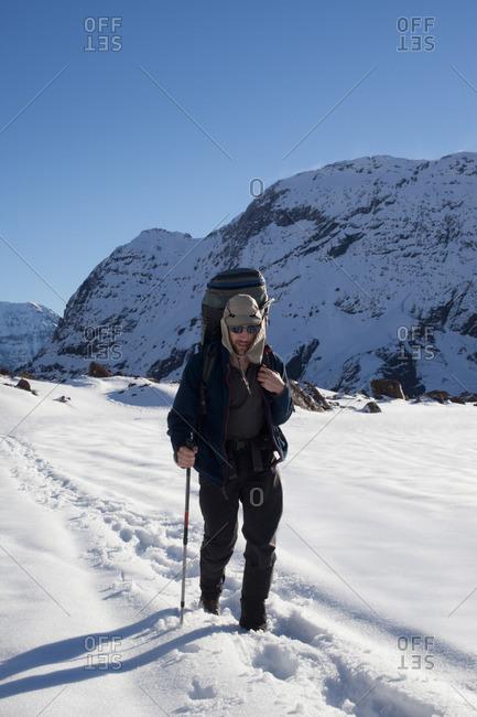 Male mountain climber climbing mountain, Santiago, Chile