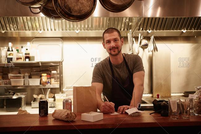 Portrait of restaurant worker at counter in restaurant
