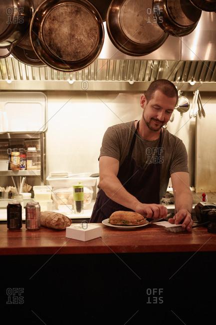 Restaurant worker at counter in restaurant