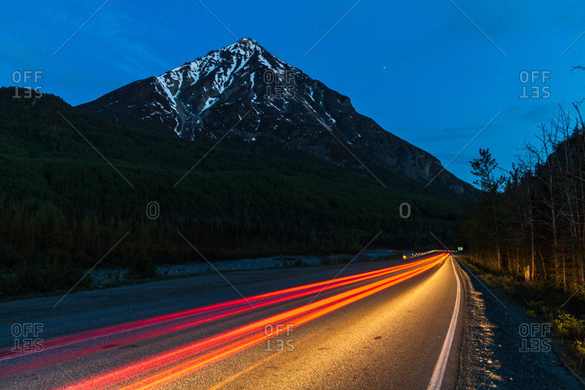 Light trails on road at night, British Columbia, Canada