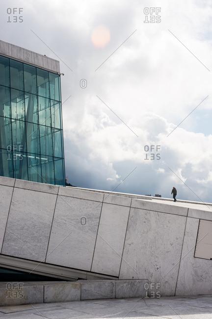 Oslo, Norway - April 30, 2015: Man walking at the Oslo Opera House