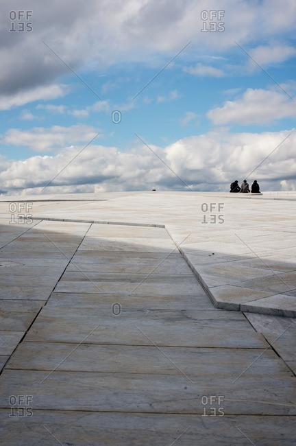 Oslo, Norway - April 30, 2015: People sitting on the roof at the Oslo Opera House