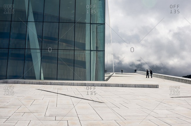 Oslo, Norway - April 30, 2015: People walking at the Oslo Opera House in Norway