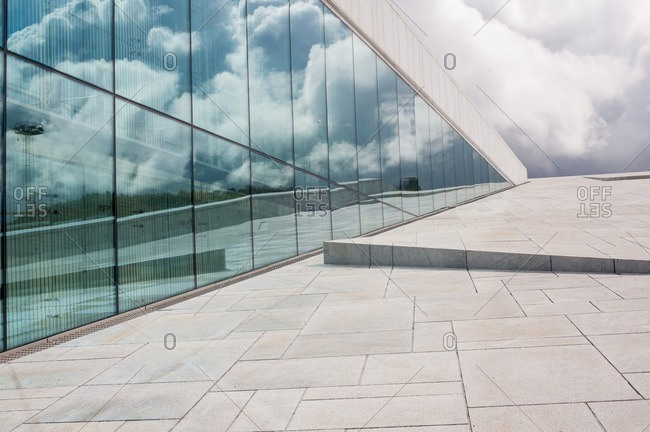 Oslo, Norway - April 30, 2015: Reflection in the windows on the Oslo Opera House
