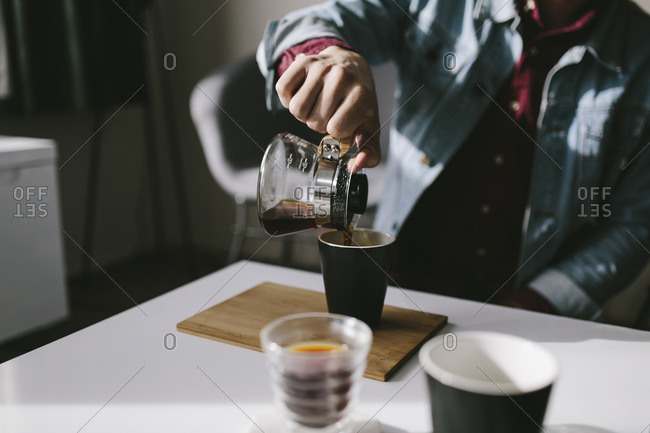 Man pouring himself coffee