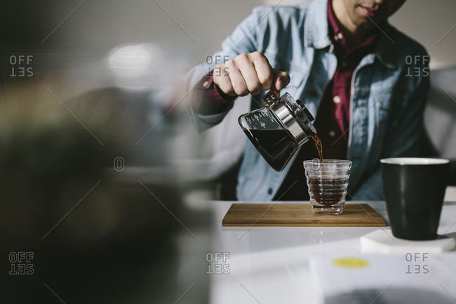 Man pouring himself a coffee