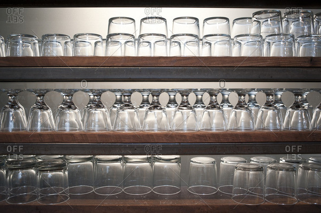 Bar glasses arranged on shelves