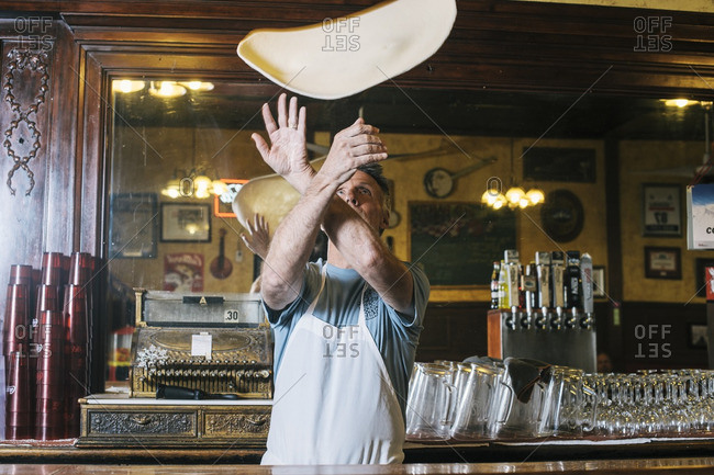 April 27, 2015: Man tossing pizza dough into the air