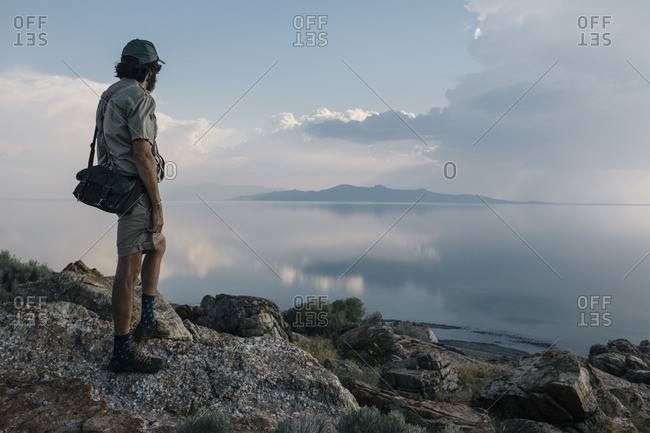 Man overlooking lake