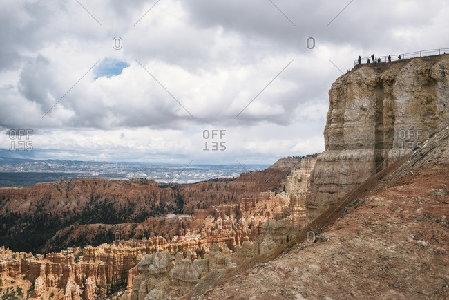 Tourists overlooking mountain landscape - Offset
