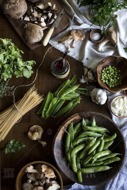 Ingredients for creamy mushroom pasta with fresh peas, ricotta and shiitake mushrooms