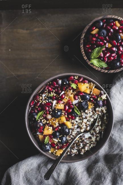 Coconut quinoa porridge topped with berries and quinoa crunch
