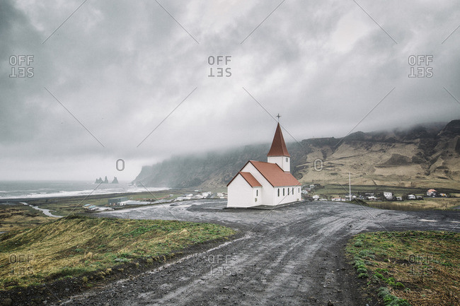 View to village and church under dramatic sky