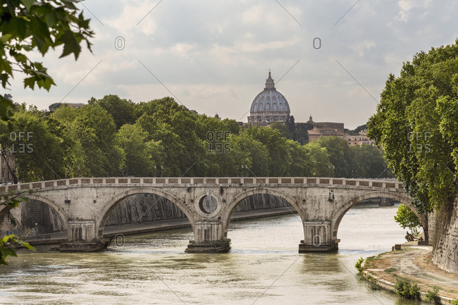 Ponte Sisto over Tiber river with the cupola of St Peter's Basilica